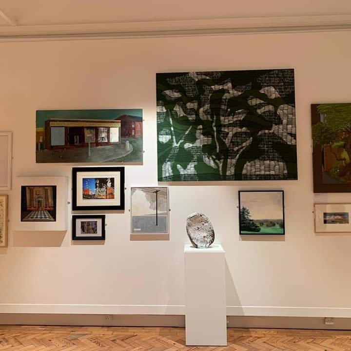 Gallery wall with paintings at the Cooper Prize Exhibition 2021